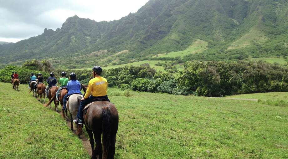 The 4,000-acre Kualoa Ranch on the North Shore of O'ahu offers plenty for adventuresome visitors, including all-terrain vehicle trips and horseback tours. Photo: Photos By Richard A. Marini / San Antonio Express-News
