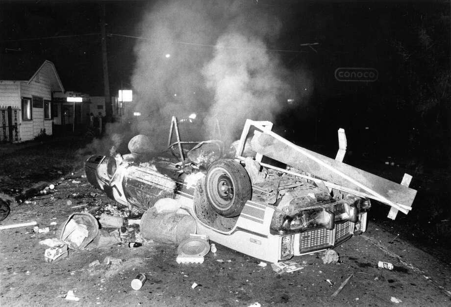Burning car near Houston's Moody Park, May 7, 1978. Photo: Jerry Click, © Houston Chronicle / Houston Post files