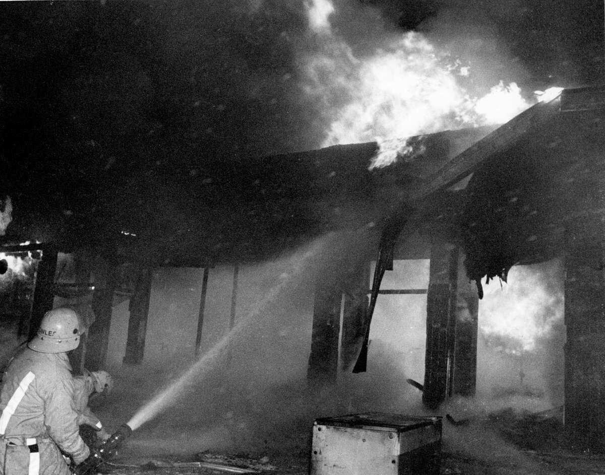 May 7, 1978: Houston firemen fight blaze reportedly set by rioters in the 4400 block of Fulton. Three buildings in the shopping center were gutted by the fire.