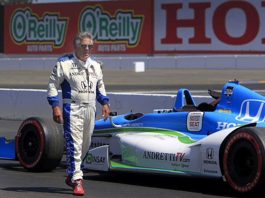 Mario Andretti, now 74 and an ambassador for IndyCar, walks past his two-seater before driving Chronicle sportswriter Tom FitzGerald on a lap around Sonoma Raceway. Photo: Paul Chinn, The Chronicle
