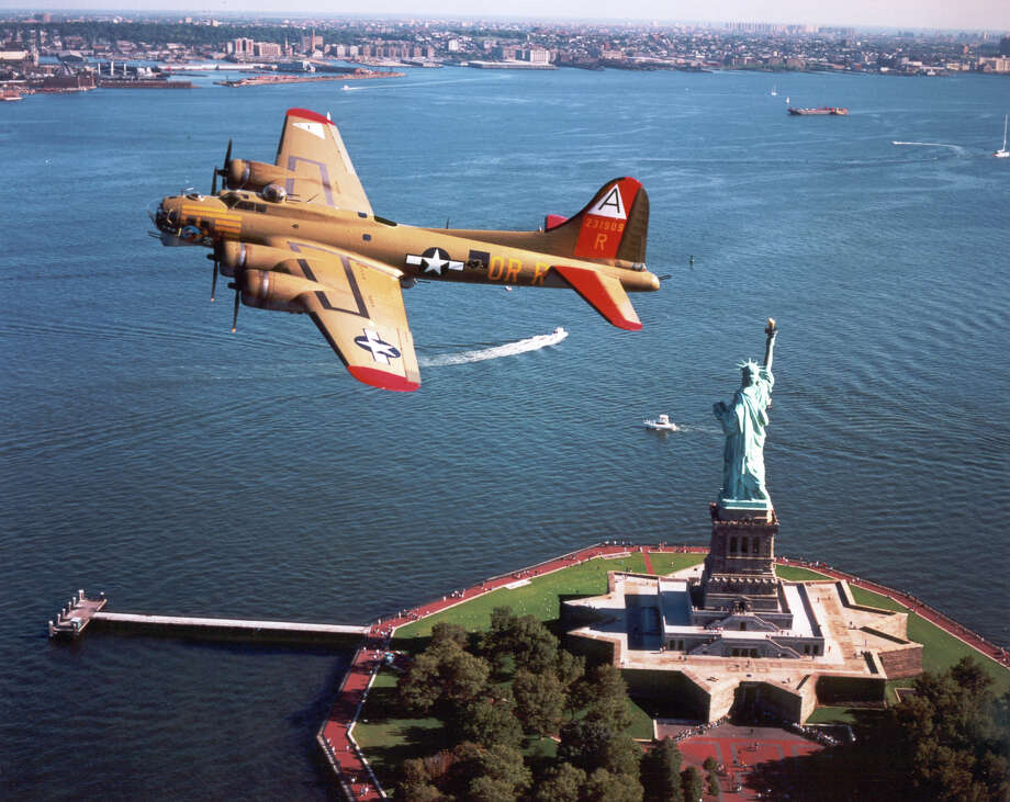 The Collings Foundation's World War II Boeing B-17 Flying Fortress, shown flying above the Statue of Liberty, comes to Sikorsky Memorial Airport, in Stratford, Tuesday, Sept. 2, to Friday, Sept. 5. Photo: Contributed Photo / Connecticut Post Contributed