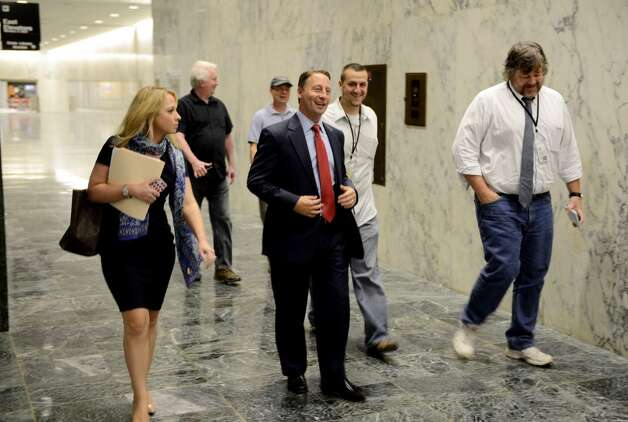 Republican gubernatorial candidate Rob Astorino, center, walks through the Legislative Office Building on his way to a press conference where he unveiled a new economic plan aimed at improving the state's business climate and promoting growth Thursday, Aug. 21, 2014, in Albany. Photo: Will Waldron, Albany Times Union