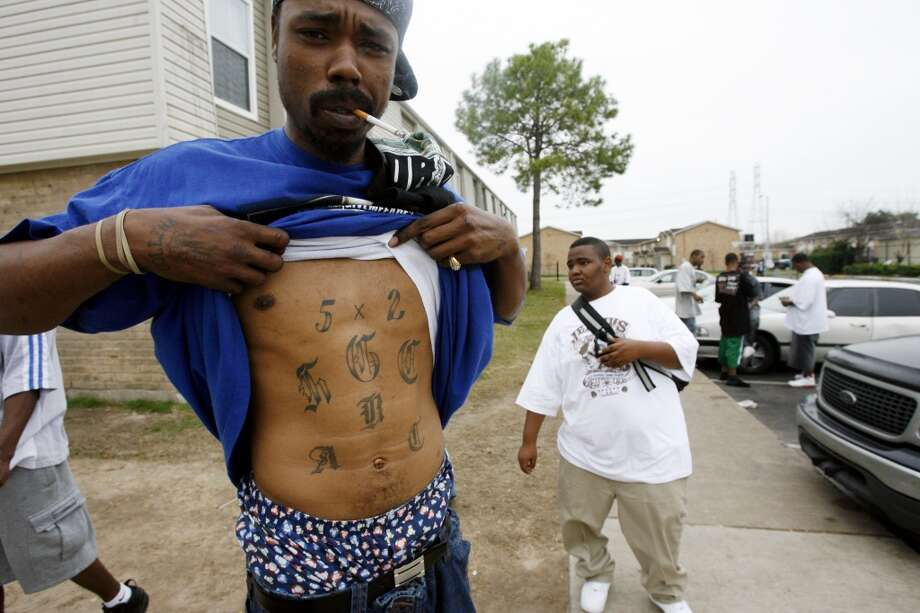 Things to know about 52 Hoover Crips, the gang linked to suspects in