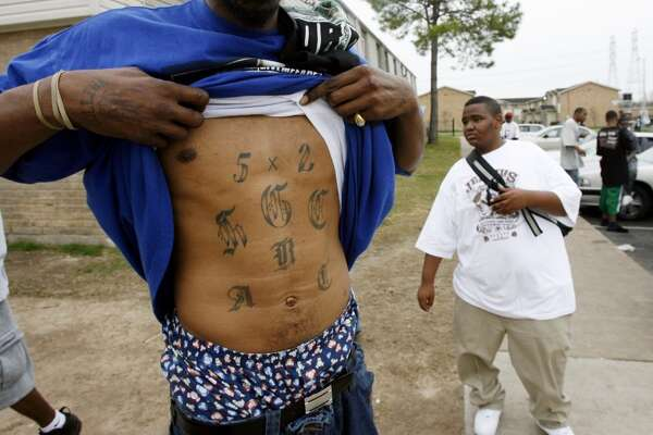 Houston news sports business and entertainment the for 52 hoover crip tattoos