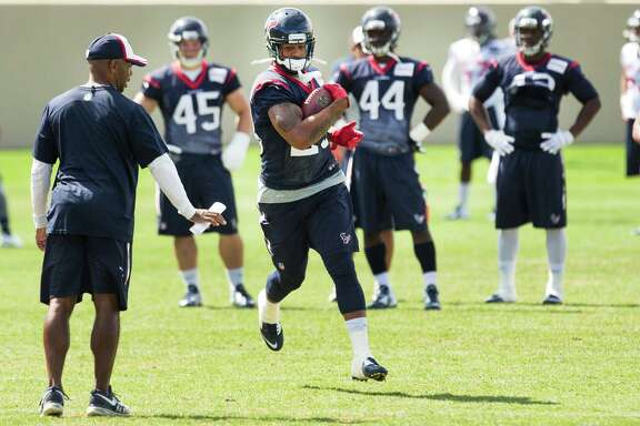 Texans running back Arian Foster, center, has had three solid days of practice, but coach Bill O'Brien is unsure if Foster will make his preseason debut Saturday.