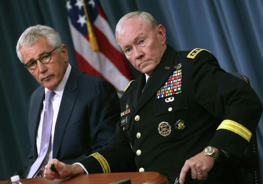 Gen. Martin Dempsey (right), chairman of the Joint Chiefs of Staff, with Defense Secretary Chuck Hagel, said the Islamic State militants can't be defeated without attacking it in Syria. Photo: Mark Wilson / Getty Images / 2014 Getty Images
