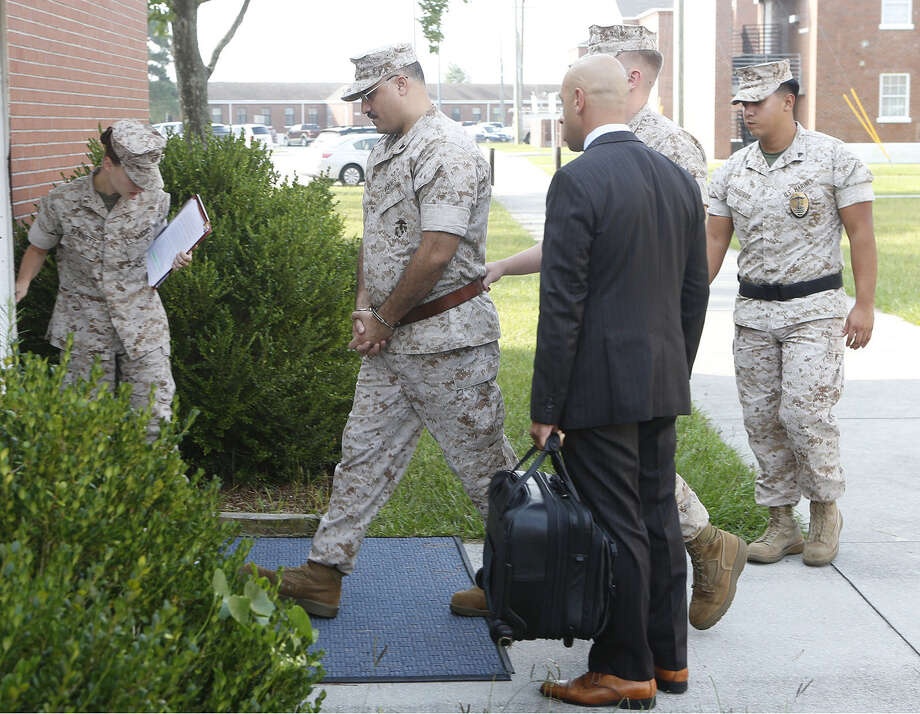 Defense attorneys escort Cpl. Wassef Ali Hassoun (wearing handcuffs) to his article 32 hearing at Camp Lejeune, N.C. Photo: John Althouse / Associated Press / The Jacksonville Daily News