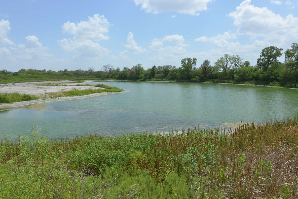 The lake of the Red Berry Mansion at 856 Gembler Rd. near the ATT Center is part of a redevelopment plan that calls for residential and commercial development.