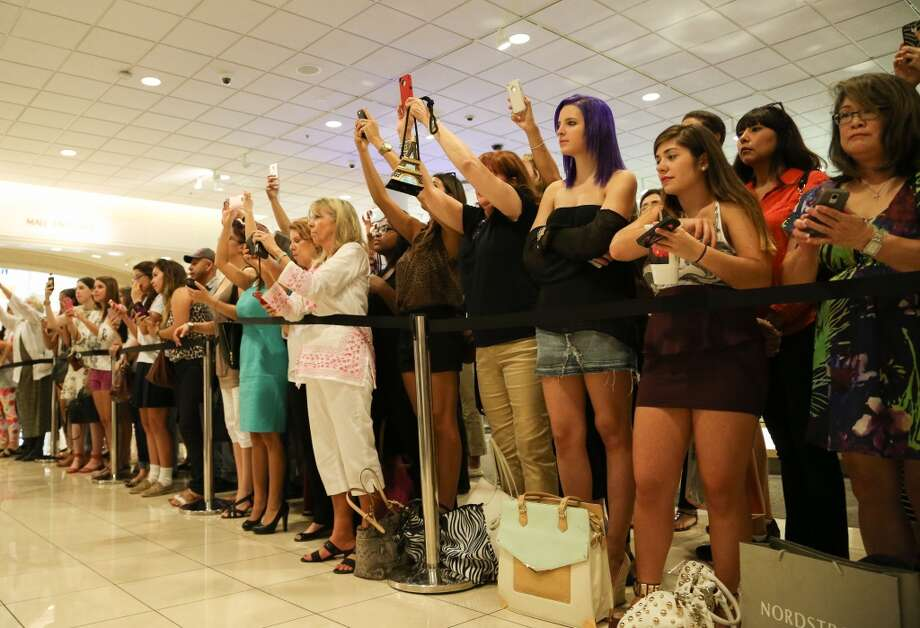 "Fans line up for a chance to meet actress-designer Sarah Jessica Parker at  Nordstrom Galleria on Aug. 21. Parker visited Houston to promote her new ""SJP"" line of shoes. Photo: Andrew Richardson, Houston Chronicle"