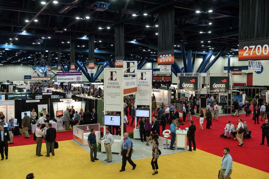 Attendees look for bargains on oil and gas properties at the North American Prospect Expo Aug. 21, 2014 at the George R. Brown Convention Center. Organizers said about 6,000 attended the annual NAPE South show. (Photo: Business Wire) Photo: Business Wire