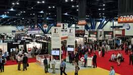 Attendees look for bargains on oil and gas properties at the North American Prospect Expo Aug. 21, 2014 at the George R. Brown Convention Center. Organizers said about 6,000 attended the annual NAPE South show. (Photo: Business Wire)