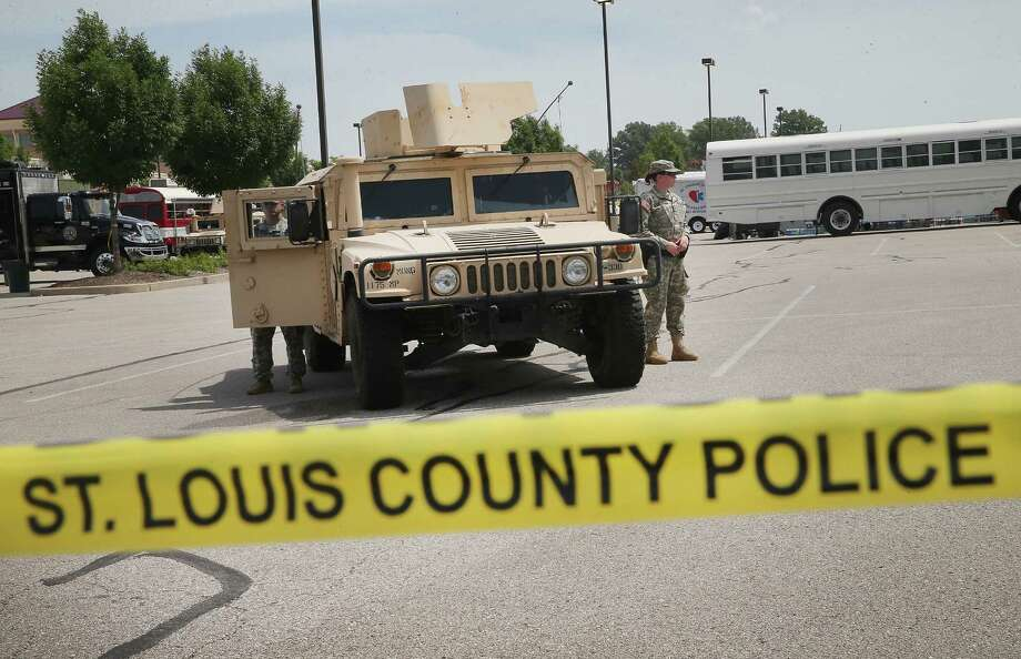 Military police with the Missouri National Guard at the police command center, which was established to direct security operations in Ferguson, Missouri, will be leaving, along with other guard members, as per Gov. Jay Nixon's order. Photo: Scott Olson / Getty Images / 2014 Getty Images