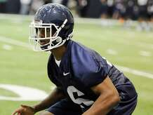 Connecticut football player Byron Jones runs during the first NCAA college football practice, Saturday, Aug. 2, 2014, in Storrs, Conn. (AP Photo/Jessica Hill)