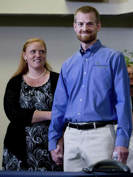 Dr. Kent Brantly stands with his wife, Amber, during a news conference after being released from Emory University Hospital in Atlanta. Photo: John Bazemore / Associated Press / AP