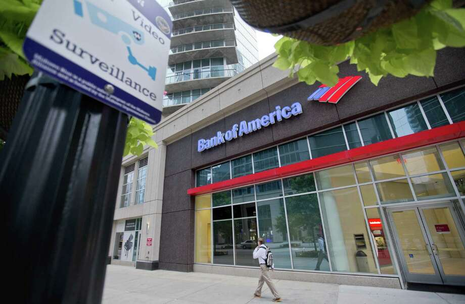 Bank of America's $16.7 billion settlement includes $9.65 billion in cash and $7 billion in consumer relief to resolve civil investigations by government prosecutors. Photo: Associated Press File Photo / AP