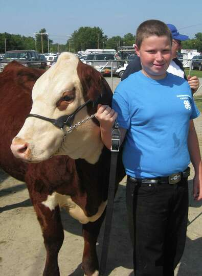 Wyatt Coluccio, standing with a heifer, is among those eager for demonstrations at the Schaghticoke