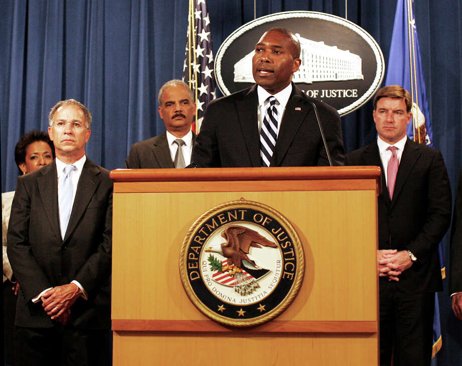 Associate Attorney General Tony West, at podium, and other officials announce Thursday the record $16.7 billion settlement with Bank of America.  Photo: Lauren Victoria Burke, FRE / FR132934 AP