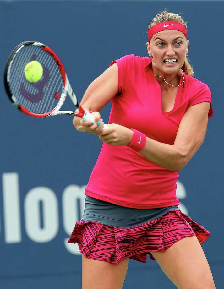 NEW HAVEN, CT - AUGUST 21:  Petra Kvitova of the Czech Republic returns a shot to Barbora Zhlavova Strycova of the Czech Republic during the Connecticut Open at the Connecticut Tennis Center at Yale on August 21, 2014 in New Haven, Connecticut. Photo: Elsa, Getty Images / 2014 Getty Images