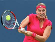 NEW HAVEN, CT - AUGUST 21:  Petra Kvitova of the Czech Republic returns a shot to Barbora Zhlavova Strycova of the Czech Republic during the Connecticut Open at the Connecticut Tennis Center at Yale on August 21, 2014 in New Haven, Connecticut.