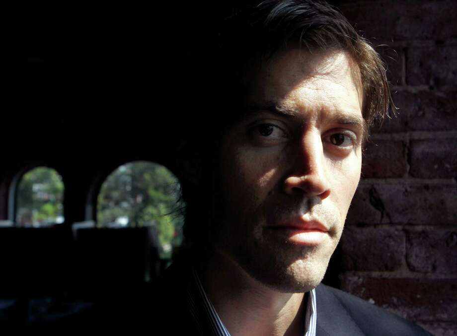 FILE - In this May 27, 2011, file photo shows American Journalist James Foley, of Rochester, N.H., as he poses for a photo in Boston. The beheading of Foley has forced a new debate over how the United States balances its unyielding policy against paying ransom to terrorist groups and saving the lives of Americans being held hostage by some of the world's most dangerous extremists. (AP Photo/Steven Senne, File) Photo: Steven Senne, STF / AP