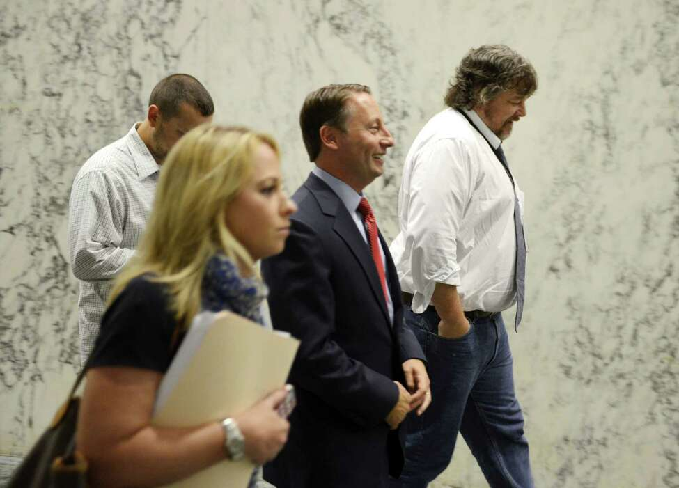 Republican gubernatorial candidate Rob Astorino, center, walks through the Legislative Office Building on his way to a press conference where he unveiled a new economic plan aimed at improving the state's business climate and promoting growth Thursday, Aug. 21, 2014, in Albany, N.Y. The plan called for a number of changes: reducing taxes and regulations, moving forward with natural gas development, investing in infrastructure, accelerating hi-tech startup-creation, modernizing the workforce, and strengthening the state's agricultural economy through tax incentives and toll breaks. (Will Waldron/Times Union)