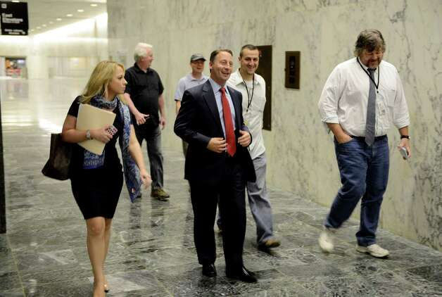 Republican gubernatorial candidate Rob Astorino, center, walks through the Legislative Office Building on his way to a press conference where he unveiled a new economic plan aimed at improving the state's business climate and promoting growth Thursday, Aug. 21, 2014, in Albany, N.Y. The plan called for a number of changes: reducing taxes and regulations, moving forward with natural gas development, investing in infrastructure, accelerating hi-tech startup-creation, modernizing the workforce, and strengthening the state's agricultural economy through tax incentives and toll breaks. (Will Waldron/Times Union) Photo: WW
