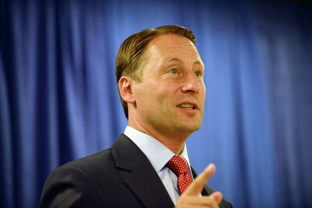 Republican gubernatorial candidate Rob Astorino unveils a new economic plan aimed at improving the state's business climate and promoting growth Thursday, Aug. 21, 2014, during a news conference at the Legislative Office Building in Albany, N.Y. The plan called for a number of changes: reducing taxes and regulations, moving forward with natural gas development, investing in infrastructure, accelerating hi-tech startup-creation, modernizing the workforce, and strengthening the state's agricultural economy through tax incentives and toll breaks. (Will Waldron/Times Union) Photo: WW