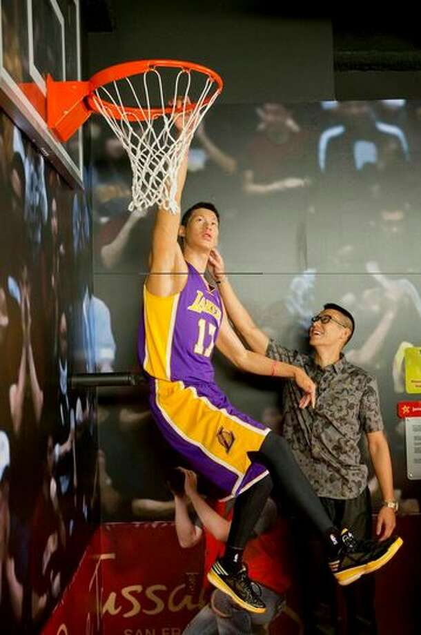 Jeremy Lin admires his wax figure at Madame Tussauds San Francisco. Photo: Beck Diefenbach, Madame Tussauds
