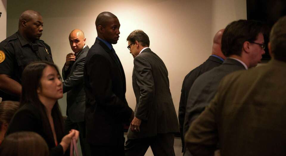 Texas Gov. Rick Perry leaves the room after speaking at the Heritage Foundation in Washington. While