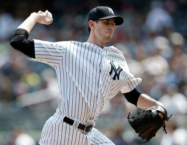 New York Yankees starting pitcher Brandon McCarthy delivers in the first inning of a baseball game against the Houston Astros at Yankee Stadium in New York, Thursday, Aug. 21, 2014.  (AP Photo/Kathy Willens) ORG XMIT: NYY101 Photo: Kathy Willens / AP