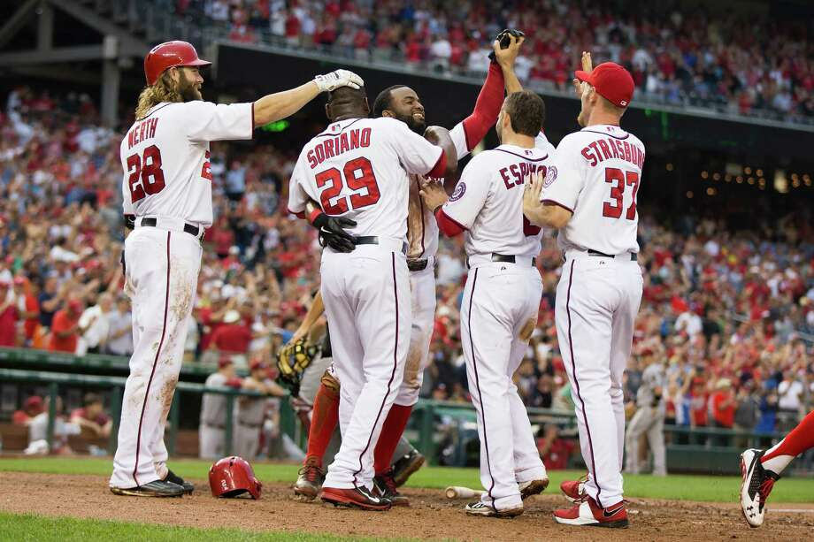 Washington Nationals Denard Span smiles as he crosses home plate after scoring the winning run on a throwing error by Arizona Diamondbacks third baseman Jordan Pacheco during the ninth inning of a baseball game on Thursday, Aug. 21, 2014, in Washington. The Nationals defeated the Diamondbacks 1-0 and extended their winning streak to 10 games. (AP Photo/Evan Vucci) Photo: Evan Vucci, STF / AP