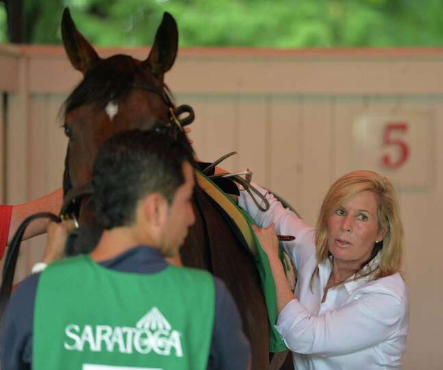 Trainer Linda Rice saddles Uncle Southern before the 11th running of the Union Avenue at the Sara