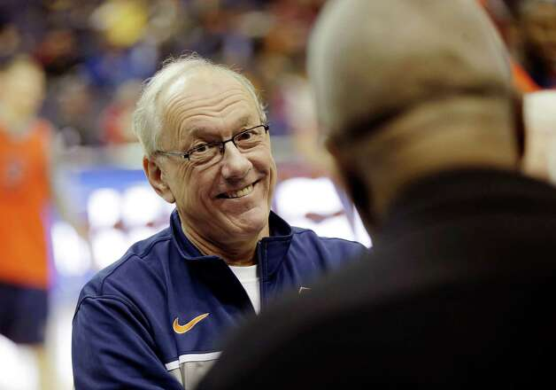 Syracuse coach Jim Boeheim, left, smiles as he talks to former Georgetown head coach John Thompson, right,  during practice for a regional semifinal game in the NCAA college basketball tournament, Wednesday, March 27, 2013, in Washington. Syracuse plays Indiana on Thursday. (AP Photo/Pablo Martinez Monsivais) Photo: Pablo Martinez Monsivais / AP