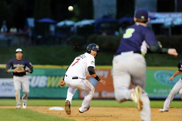 ValleyCats' Alfredo Gonzalez, center, gets caught in a rundown between first and second during their baseball game against the  Vermont Lake Monsters on Thursday, Aug. 21, 2014, at Bruno Stadium in Troy, N.Y. (Cindy Schultz / Times Union) Photo: Cindy Schultz / 00028231A