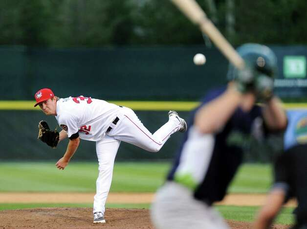 ValleyCats' Randall Fant, left, releases a pitch during their baseball game against the  Vermont Lake Monsters on Thursday, Aug. 21, 2014, at Bruno Stadium in Troy, N.Y. (Cindy Schultz / Times Union) Photo: Cindy Schultz / 00028231A