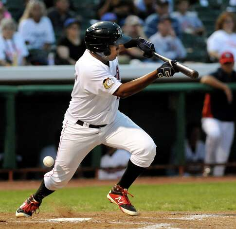ValleyCats' Juan Santana attempts a bunt during their baseball game against the  Vermont Lake Monsters on Thursday, Aug. 21, 2014, at Bruno Stadium in Troy, N.Y. (Cindy Schultz / Times Union) Photo: Cindy Schultz / 00028231A