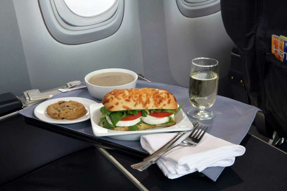 This product image provided by United Airlines shows a Caprese on Asiago Baguette sandwich, one of a variety of the airline's new first class food options.  The Chicago-based airline on Thursday, Aug. 21, 2014 announced that it's upgrading first class food options and replacing snacks with full meals on some of its shortest flights. (AP Photo/United Airlines) ORG XMIT: NYBZ125 Photo: Uncredited / United Airlines