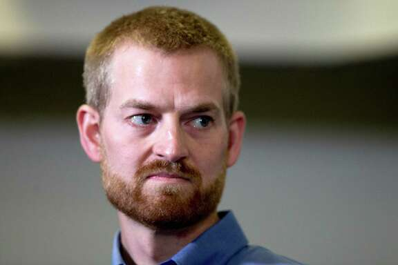 Ebola victim Dr. Kent Brantly looks on during a news conference after being released from Emory University Hospital, Thursday, Aug. 21, 2014, in Atlanta. Another American aid worker, Nancy Writebol, who was also infected with the Ebola virus, was released from the hospital Tuesday. (AP Photo/John Bazemore) ORG XMIT: GAJB102