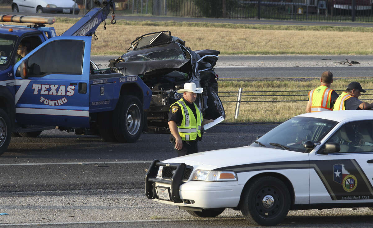 The driver of this car being removedy a wrecker died at the scene when the car crashed into a disabled car on southbound Interstate 35 near Kinney road in South Bexar County around 3 a.m. Thursday, deputies said. A tractor- trailer also hit the disabled car. The truck driver was not injured.