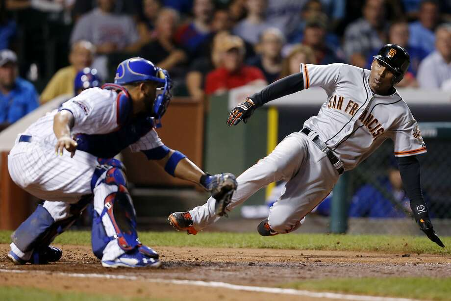 Joaquin Arias scores past Cubs catcher Welington Castillo on a hit by Madison Bumgarner in the fourth inning of the finale. Photo: Andrew Nelles, Associated Press