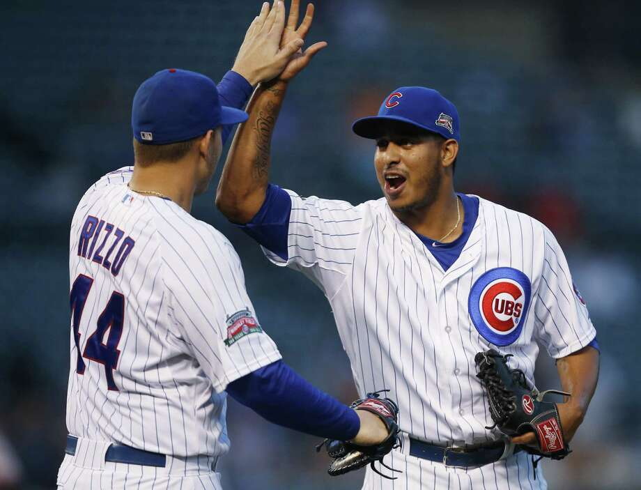 Cubs first baseman Anthony Rizzo and reliever Hector Rondon celebrate their long-delayed victory, which followed a successful appeal by San Francisco. Photo: Andrew Nelles / Associated Press / FR170974 AP