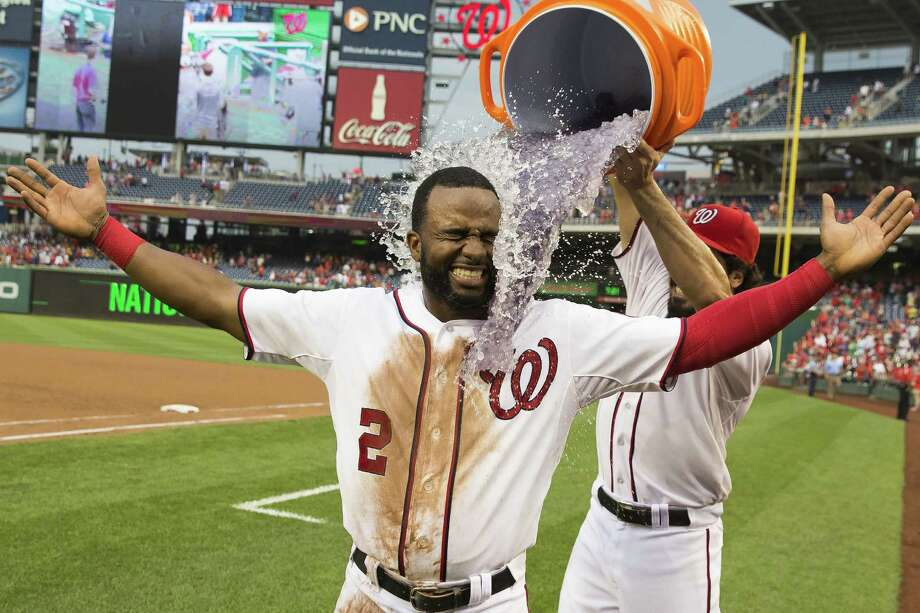 Anthony Rendon dumps water on Denard Span after the Nationals earned their 10th straight win. Photo: Evan Vucci / Associated Press / AP