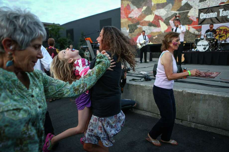 People dance as The Beatles cover band Creme Tangerine performs at Seattle Center's Mural Amphitheater on Thursday. Photo: JOSHUA TRUJILLO, SEATTLEPI.COM / SEATTLEPI.COM