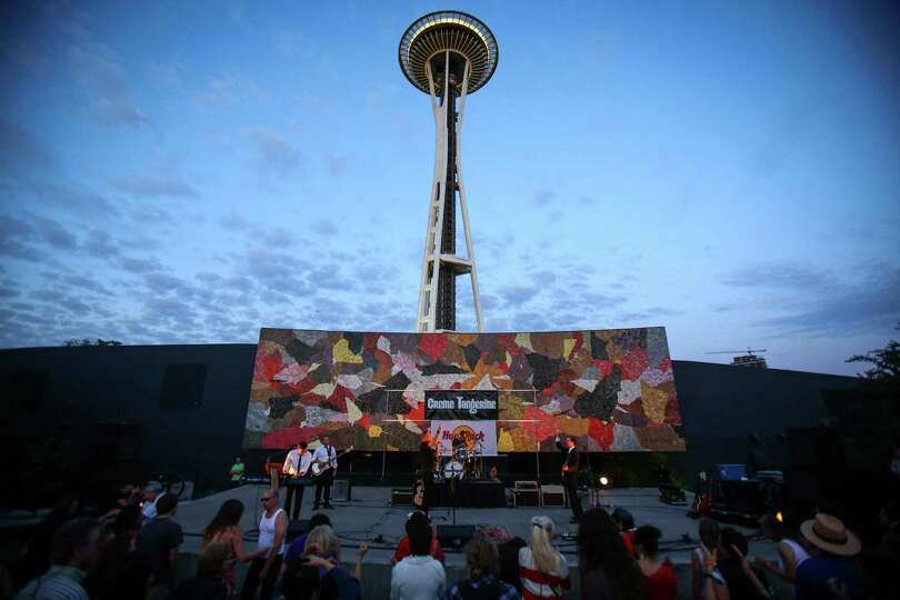 The beatles cover band creme tangerine performs at seattle for Concerts at the mural seattle
