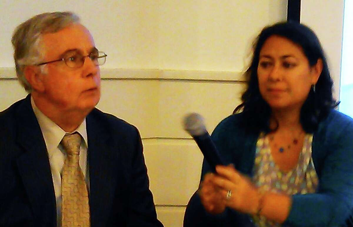 Robert E. Coulombe Jr., residential lending manager at the state Housing Development Fund, and Emmeline Harrigan, program manager of Shore Up CT, answer questions about the loan program at the Fairfield Museum and History Center.