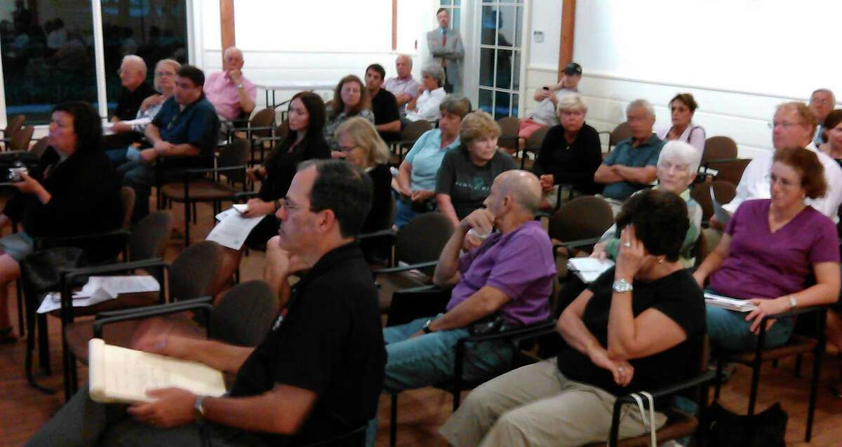 About two dozen people attended a forum on Shore Up CT, a new state loan program to elevate homes in flood zones.
