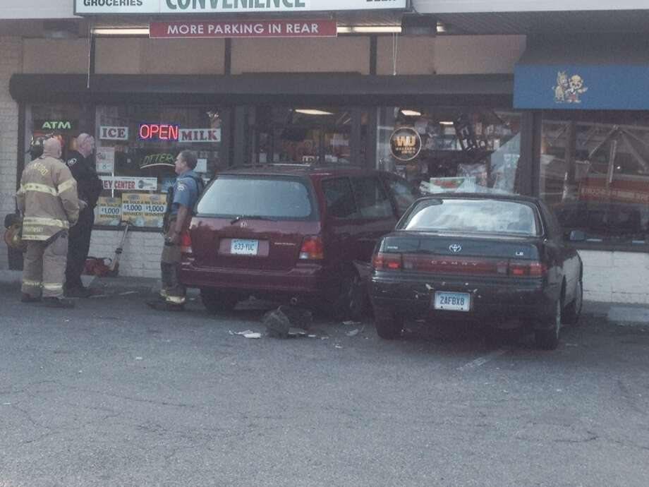 A car struck Stamford's East Main Convenience Store on Friday, Aug. 22, 2014. Photo: John Nickerson, Stamford Advocate