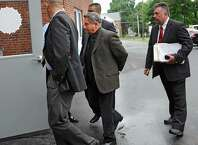 Bruce Tanski is brought to the Saratoga County Courthouse in custody by FBI agents and state attorney generals investigators on Friday, Aug. 22, 2014 in Ballston Spa, N.Y. Bruce Tanski, a prominent Halfmoon builder, was arrested by State Police on charges alleging he paid employees and business associates to make political contributions to the campaign account of Melinda Wormuth, a former Halfmoon town supervisor. (Lori Van Buren / Times Union)