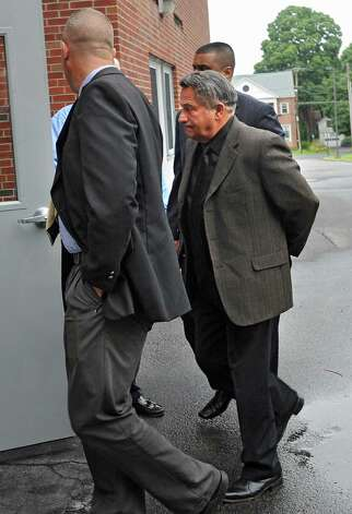 Bruce Tanski is brought to the Saratoga County Courthouse in custody by FBI agents and state Attorney General investigators on Friday, Aug. 22, 2014 in Ballston Spa, N.Y. Bruce Tanski, a prominent Halfmoon builder, was arrested by State Police on charges alleging he paid employees and business associates to make political contributions to the campaign account of Melinda Wormuth, a former Halfmoon town supervisor. (Lori Van Buren / Times Union) Photo: Lori Van Buren / 00028289A