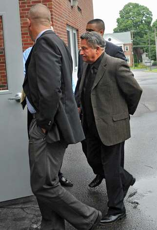 Bruce Tanski is brought to the Saratoga County Courthouse by FBI agents and state Attorney's  General investigators on Friday, Aug. 22, 2014 in Ballston Spa, N.Y. Tanski, a prominent Halfmoon builder, was arrested by State Police on charges alleging he paid employees and business associates to make political contributions to the campaign account of Melinda Wormuth, a former Halfmoon town supervisor. (Lori Van Buren / Times Union) ORG XMIT: MER2014082209152578 Photo: Lori Van Buren / 00028289A